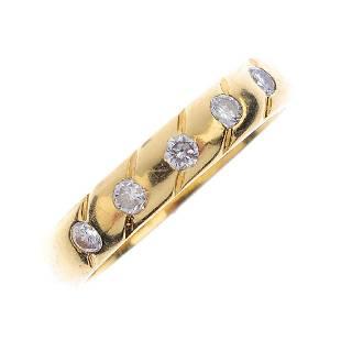An 18ct gold diamond half eternity ring The