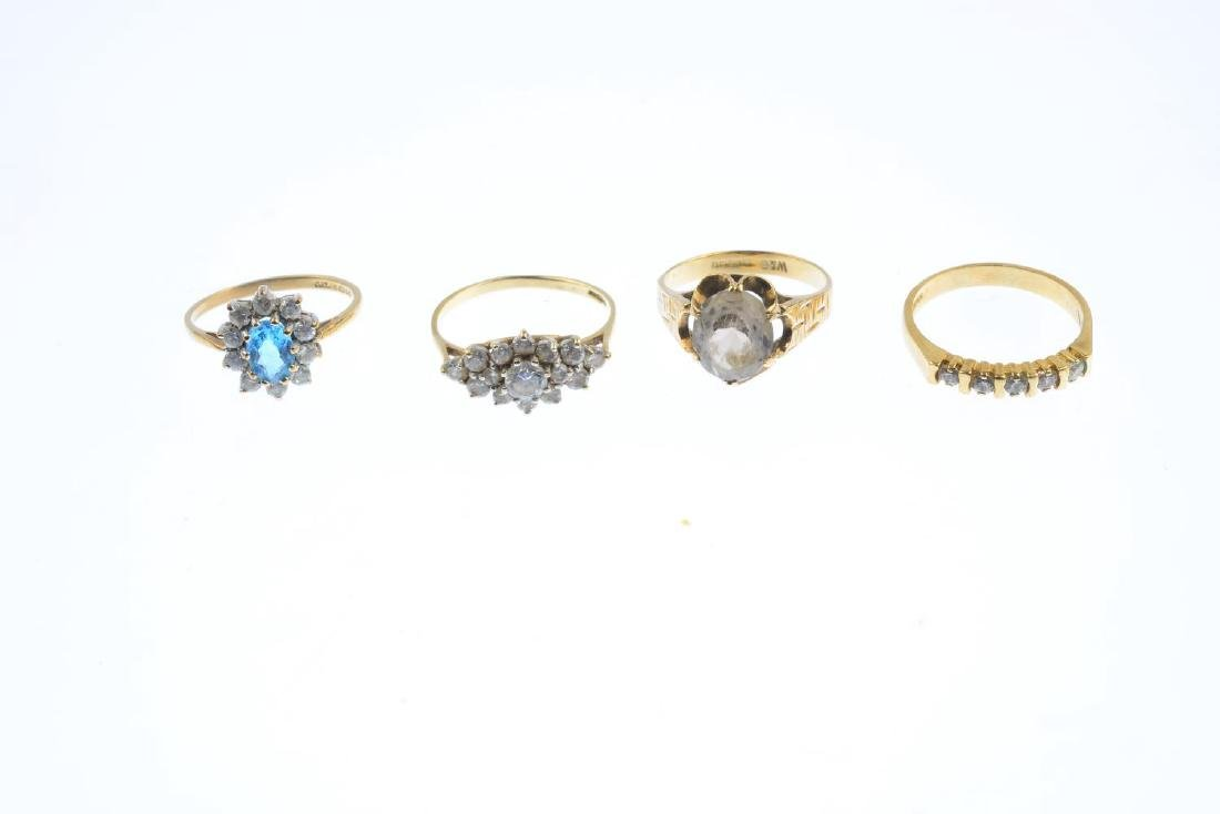 Four 9ct gold gem-set rings. To include a blue topaz - 2