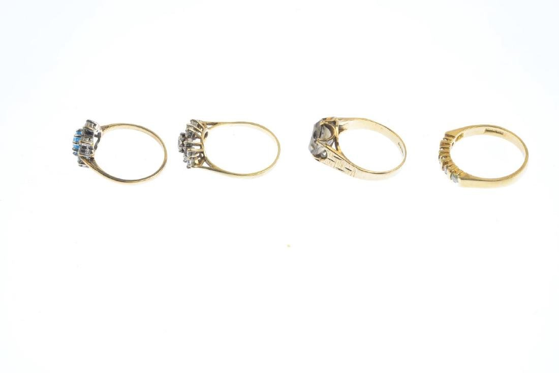 Four 9ct gold gem-set rings. To include a blue topaz - 3