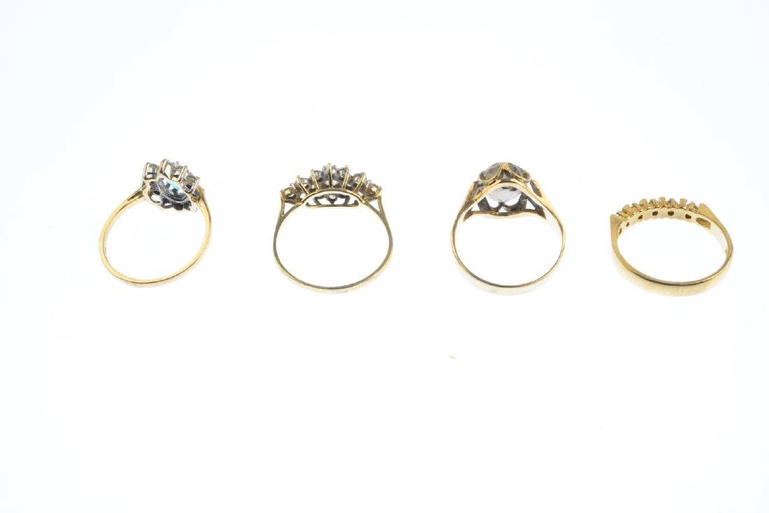 Four 9ct gold gem-set rings. To include a blue topaz - 4