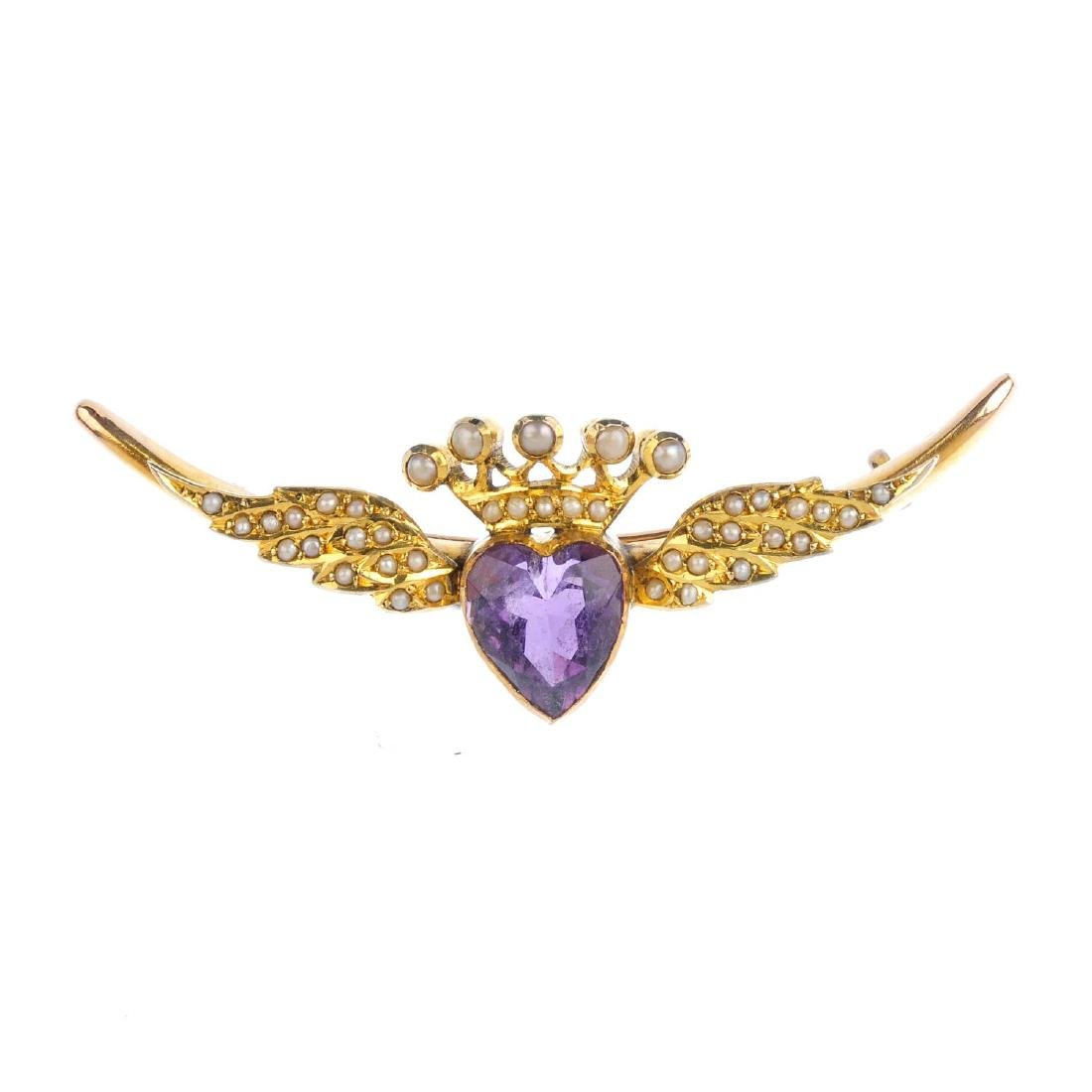 An Edwardian gold amethyst and split pearl brooch. The