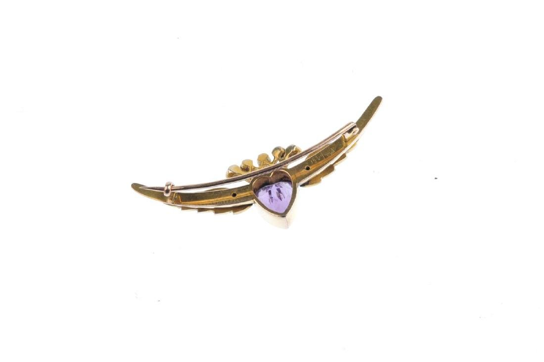 An Edwardian gold amethyst and split pearl brooch. The - 2