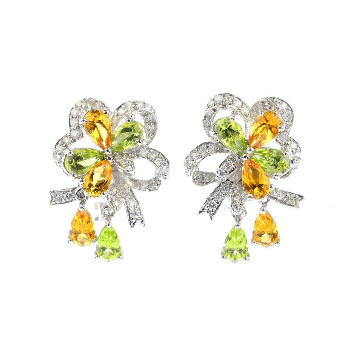 A pair of diamond, peridot and citrine earrings. Each