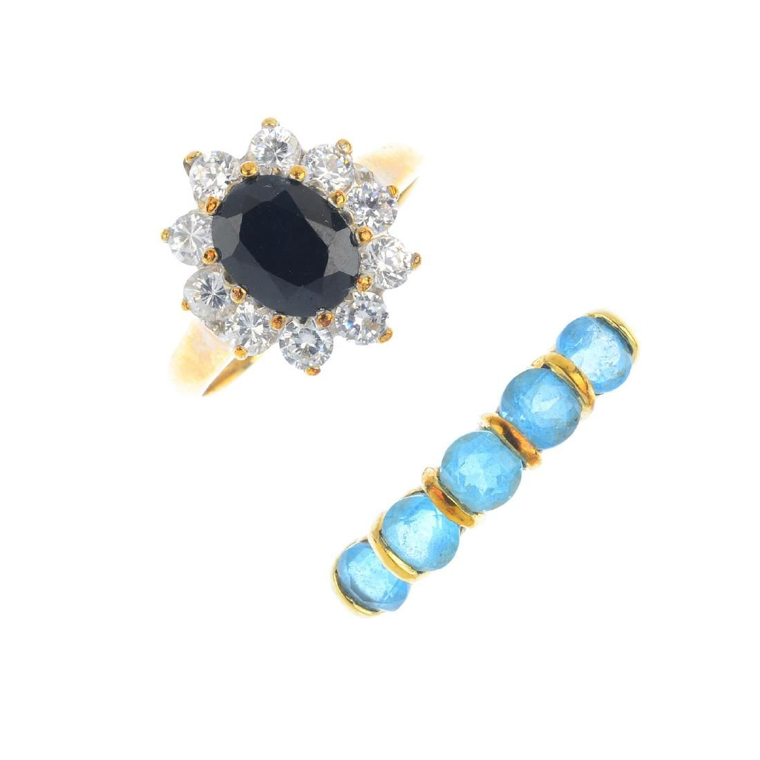 Four 9ct gold gem-set rings. To include a blue topaz