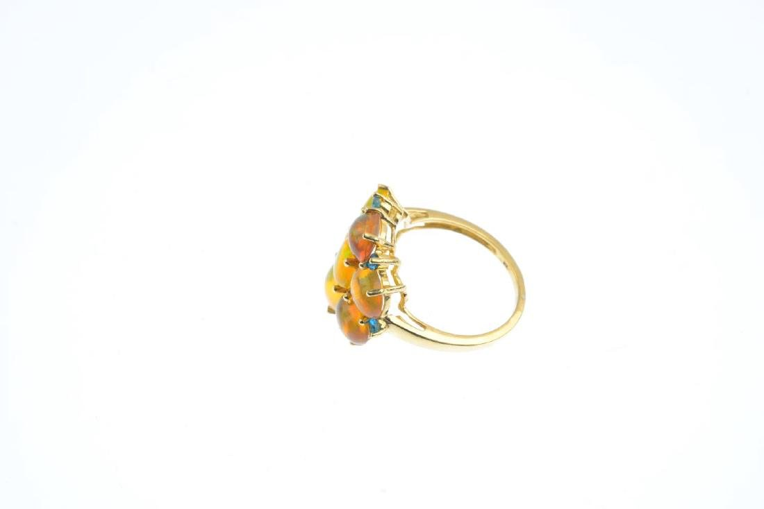 A 9ct gold opal and gem-set ring. The oval opal - 2
