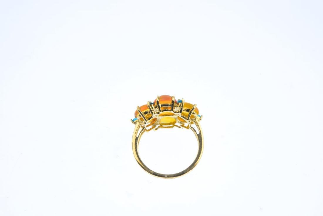 A 9ct gold opal and gem-set ring. The oval opal - 3