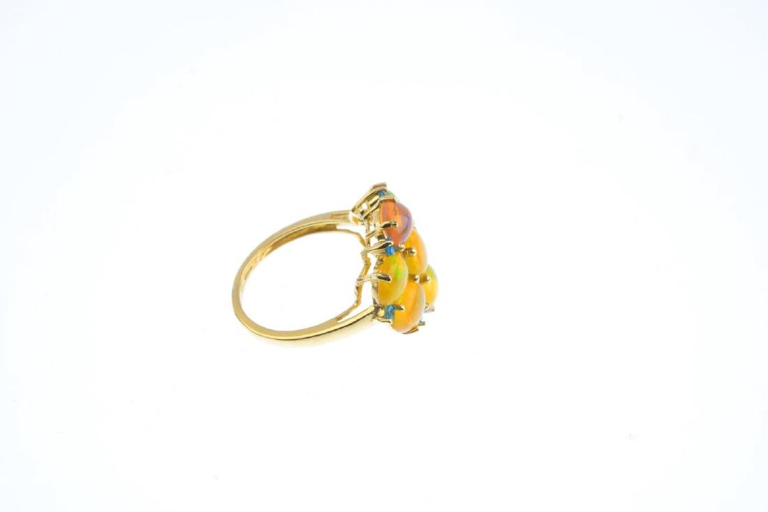 A 9ct gold opal and gem-set ring. The oval opal - 4