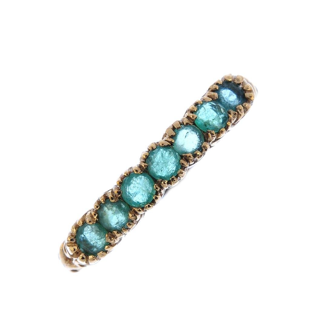 A 9ct gold emerald half eternity ring. The