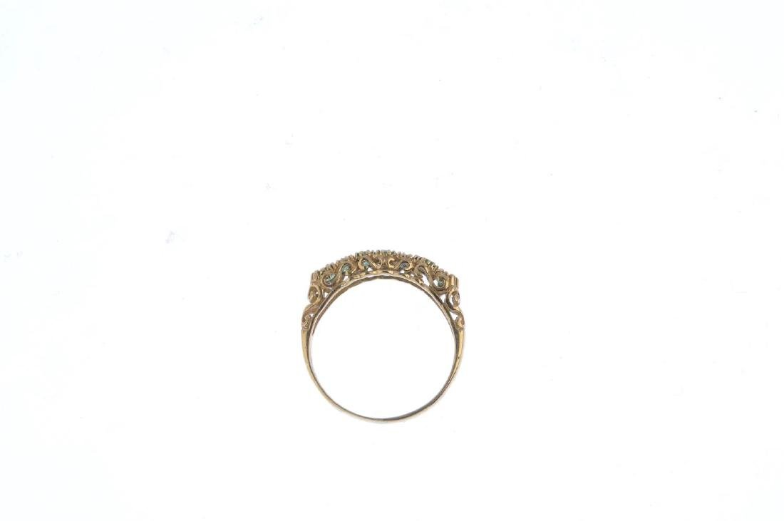 A 9ct gold emerald half eternity ring. The - 2