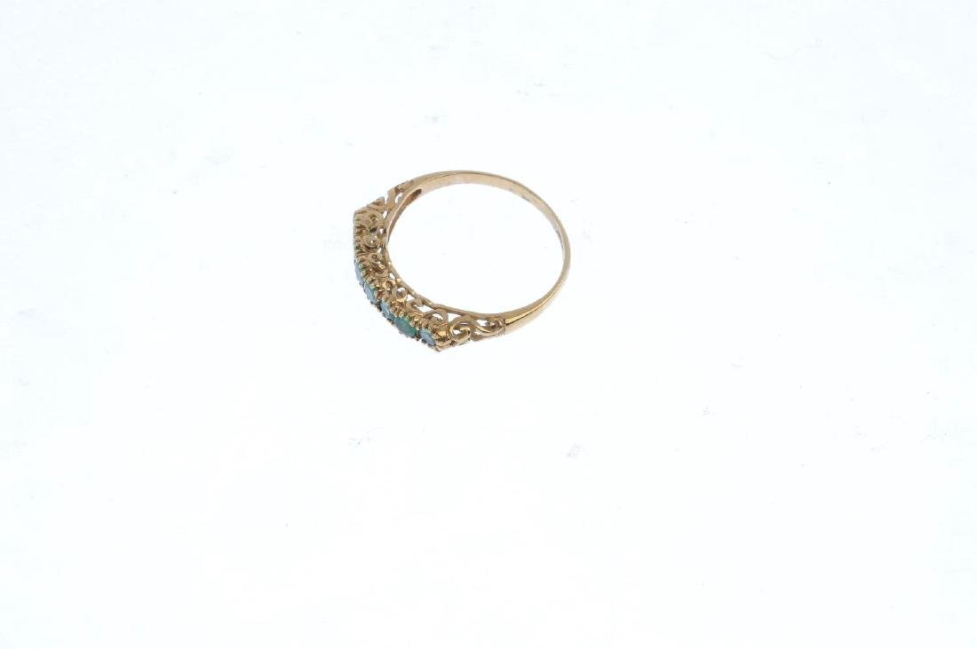A 9ct gold emerald half eternity ring. The - 3