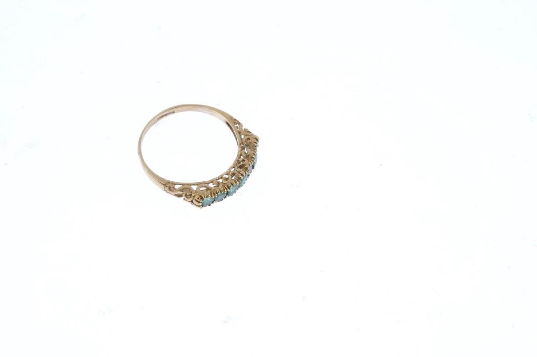 A 9ct gold emerald half eternity ring. The - 4