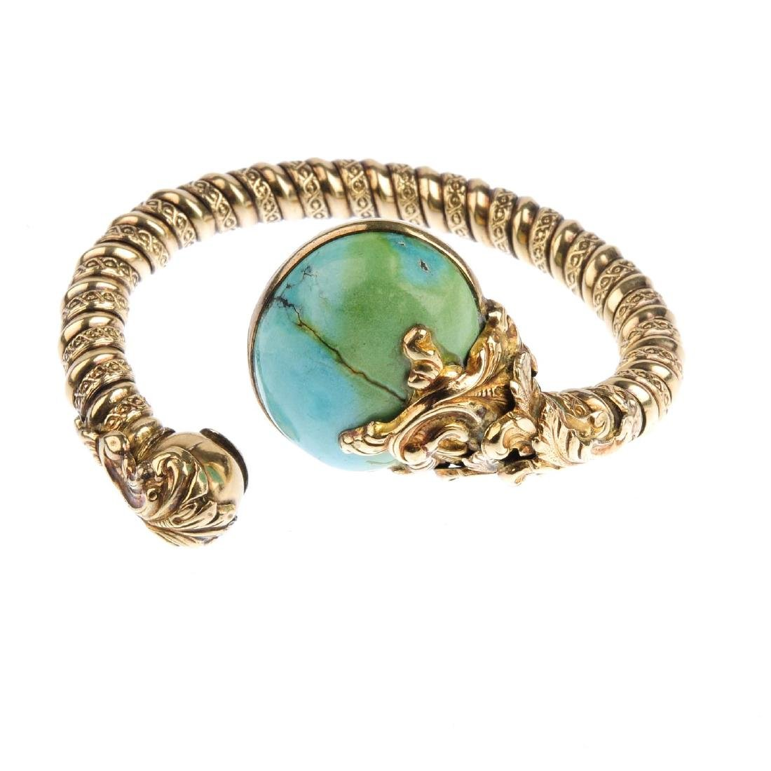 A turquoise cuff. The textured cuff, with oval