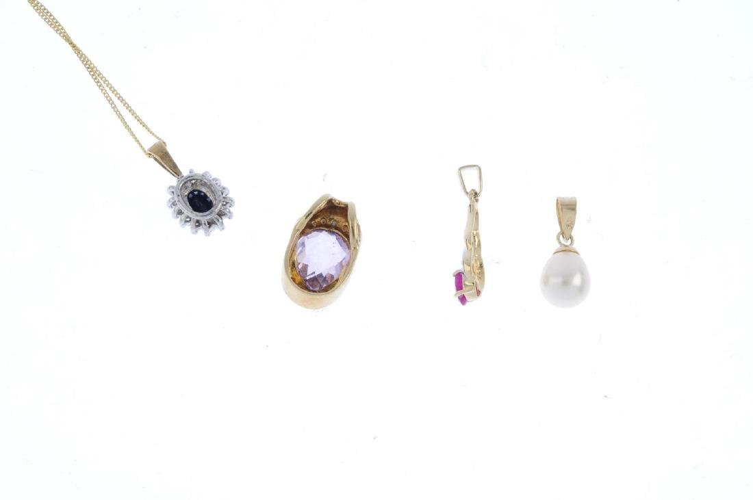 Four diamond and gem-set pendants. To include a - 2