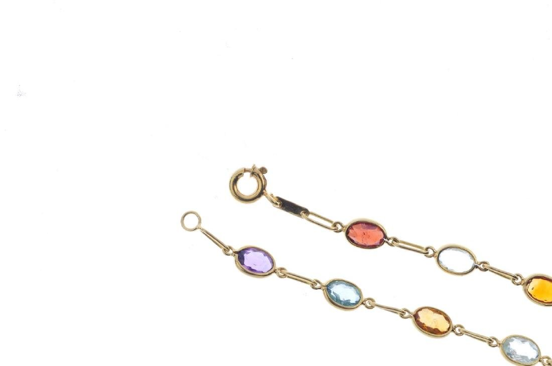 A gem-set bracelet. Designed as a series of oval-shape - 3