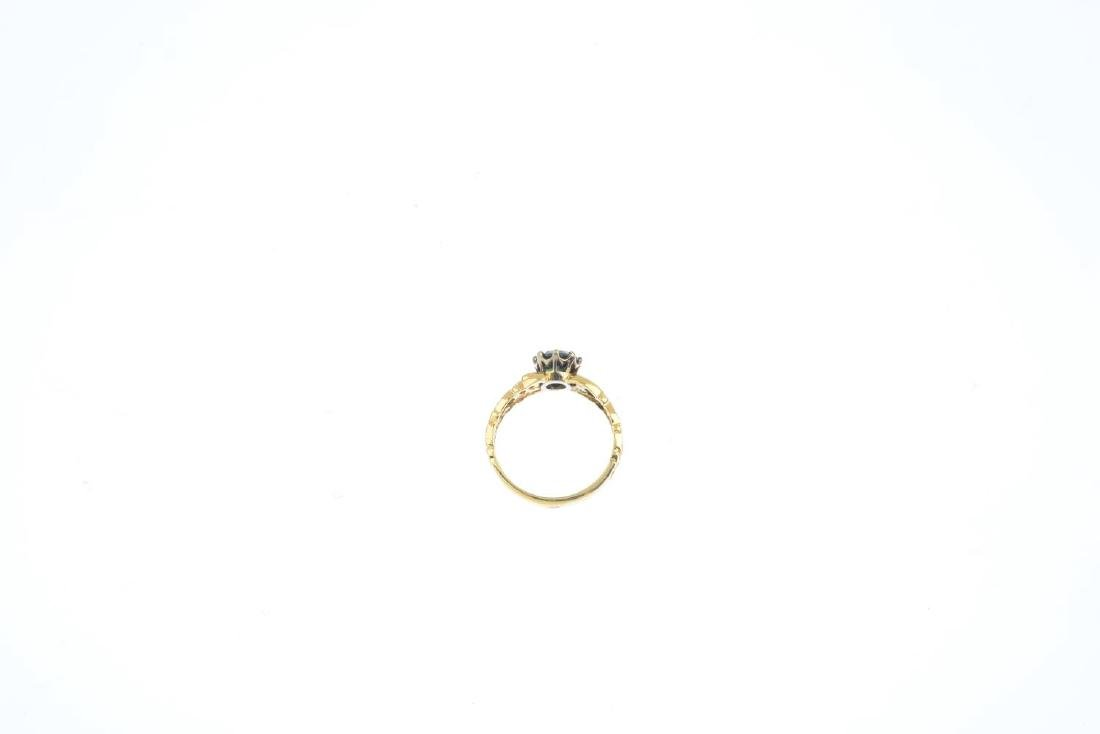 A sapphire single-stone ring. The circular-shape green - 2