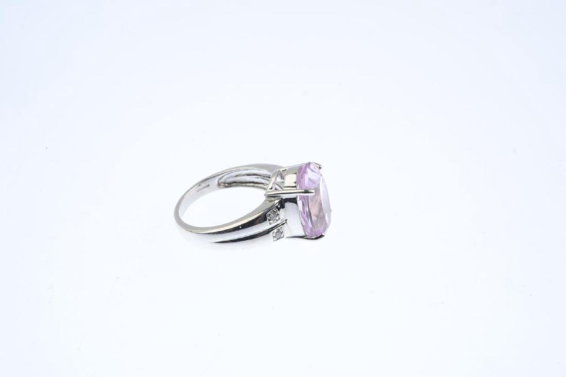 An 18ct gold kunzite and diamond ring. The oval-shape - 4