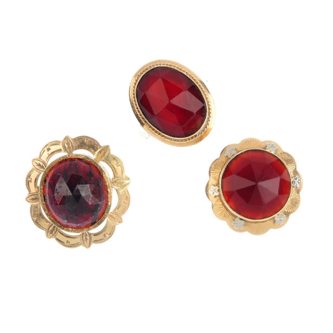 Two carnelian rings and a garnet brooch. To include a