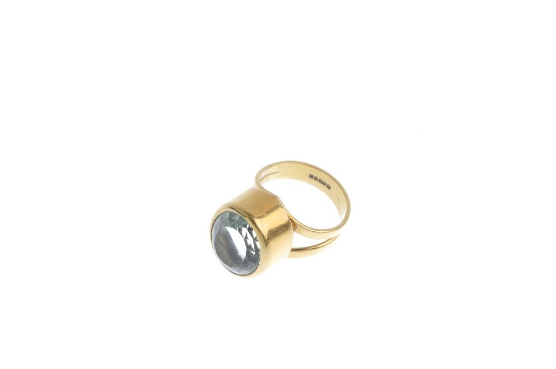 An 18ct gold aquamarine ring. The oval-shape - 3