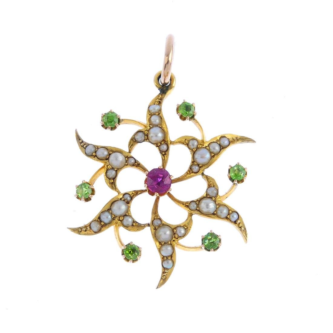 An early 20th century gold ruby, demantoid garnet and
