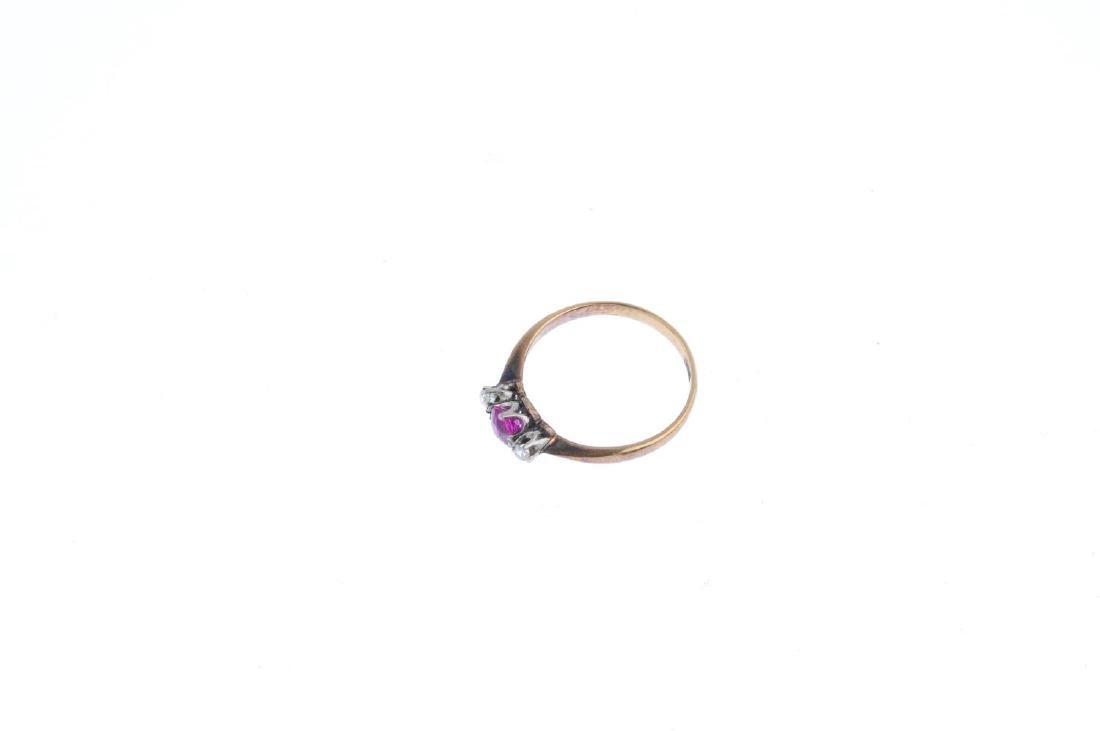 A ruby and diamond three-stone ring. The cushion-shape - 3