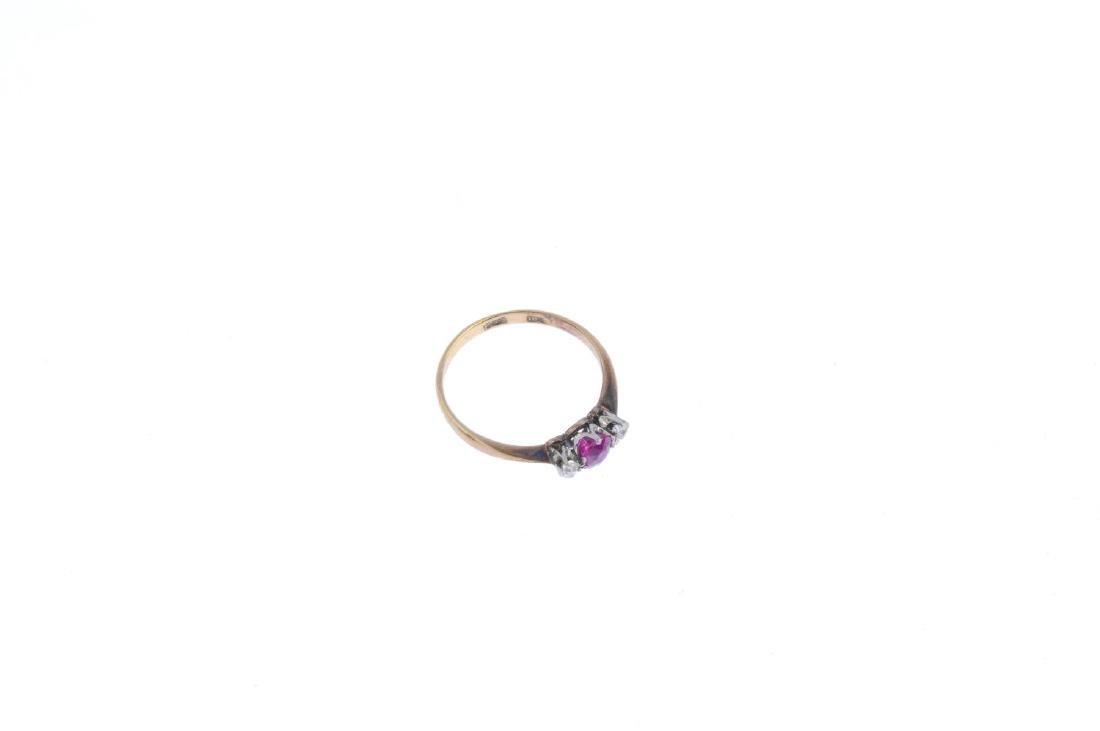 A ruby and diamond three-stone ring. The cushion-shape - 4