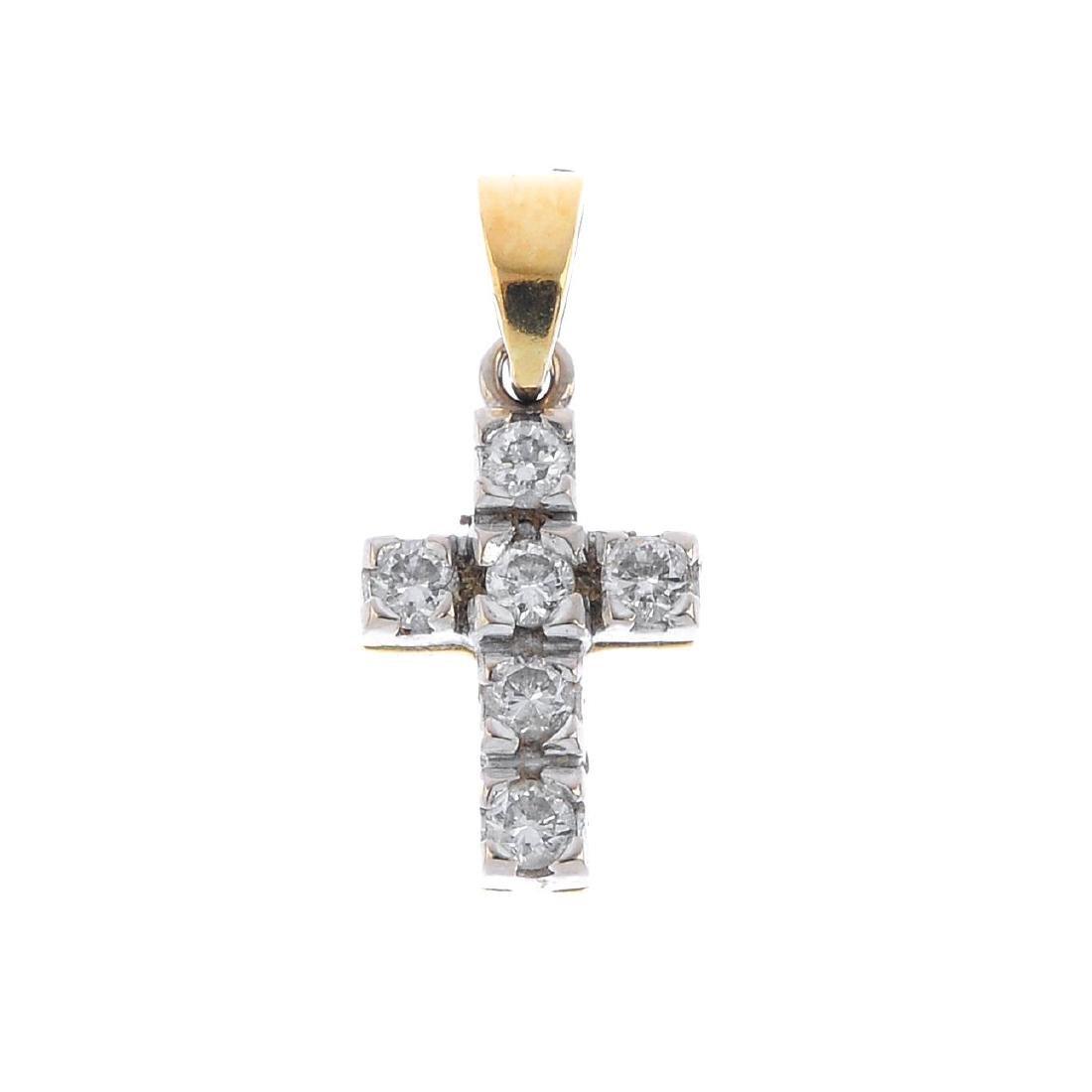 An 18ct gold diamond cross pendant. The brilliant-cut
