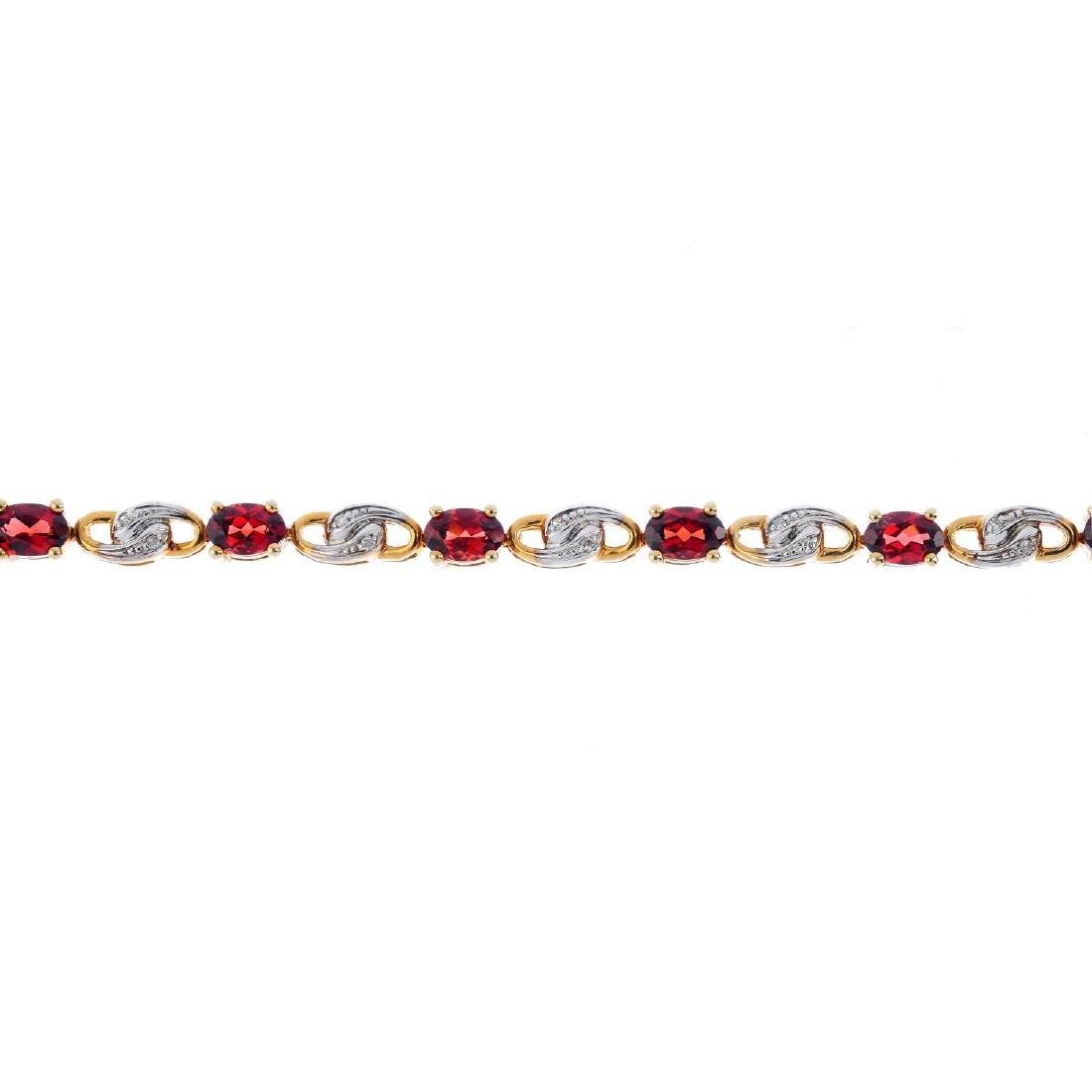 A 9ct gold garnet and diamond bracelet. Designed as a