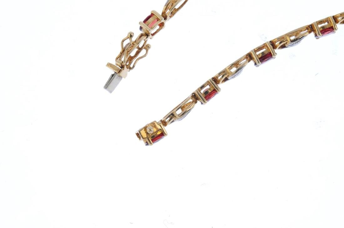 A 9ct gold garnet and diamond bracelet. Designed as a - 3