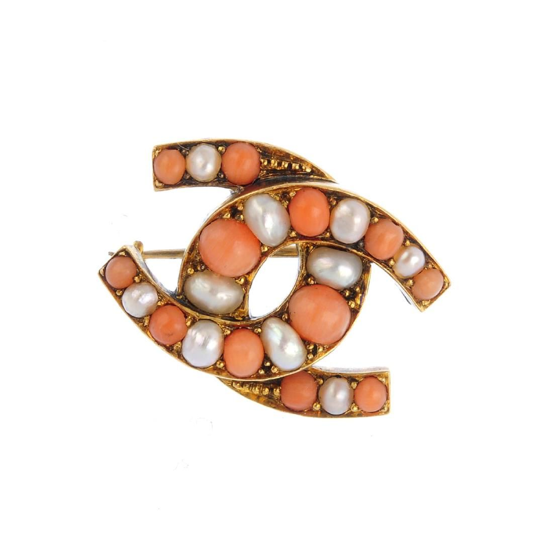 A late Victorian gold, coral and split pearl brooch.