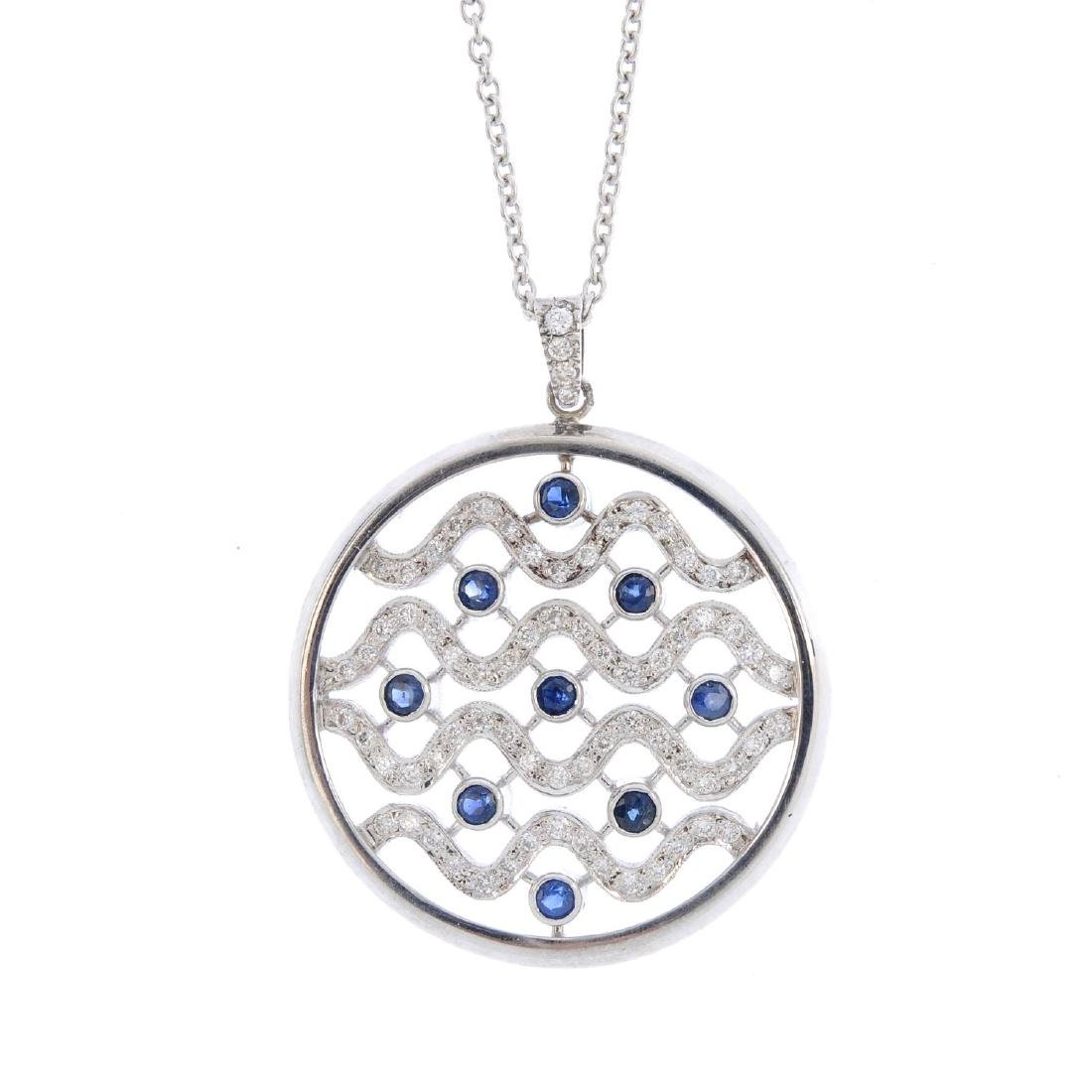 A diamond and sapphire pendant. Of circular outline,