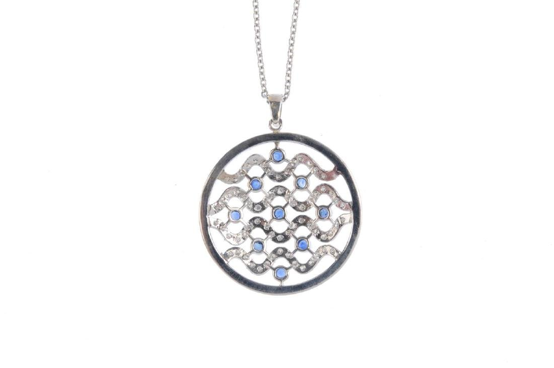 A diamond and sapphire pendant. Of circular outline, - 2