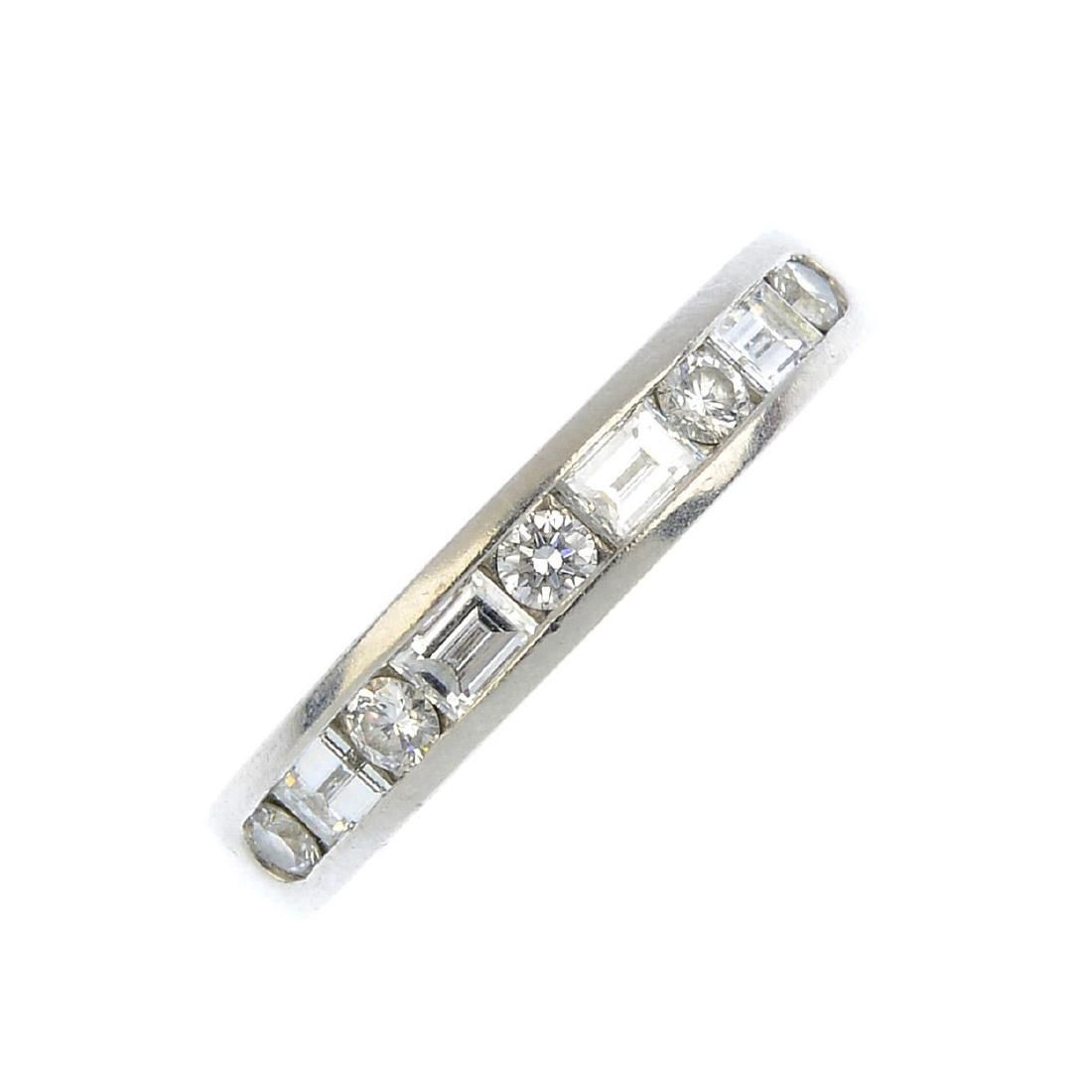 TIFFANY & CO. - a diamond half eternity ring. The