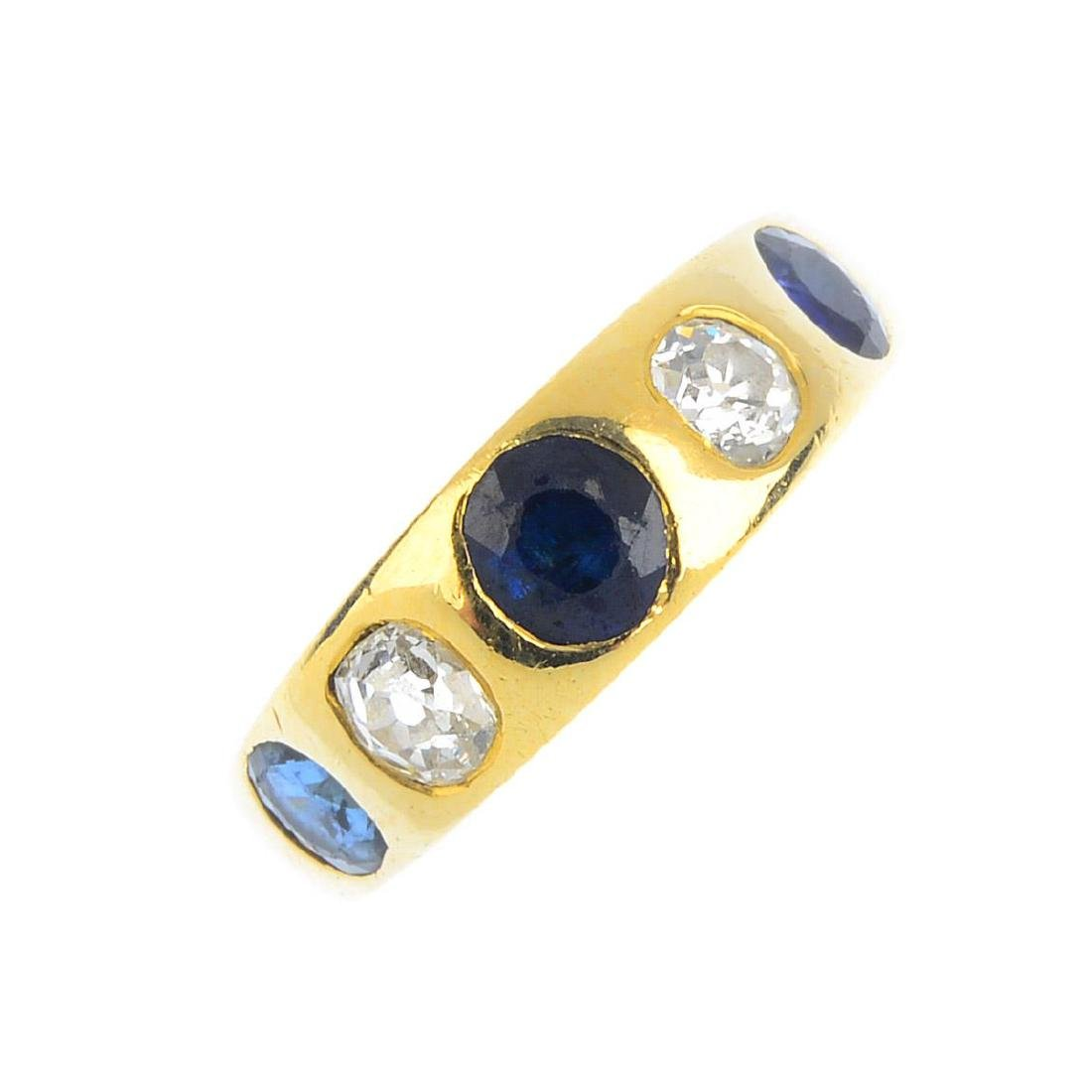 A sapphire and diamond five-stone ring. The alternating