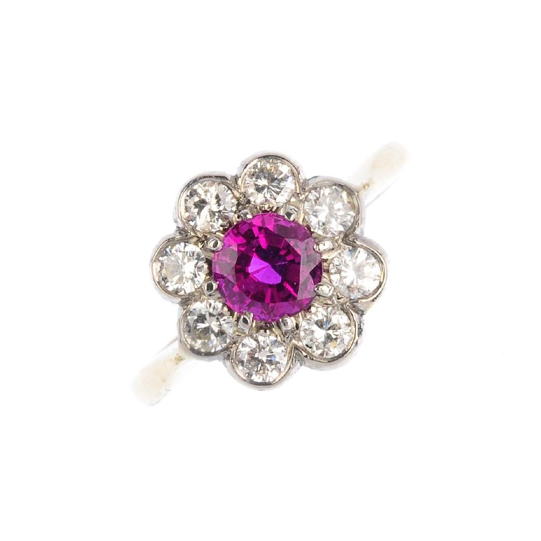 An 18ct gold Thai ruby and diamond cluster ring. The