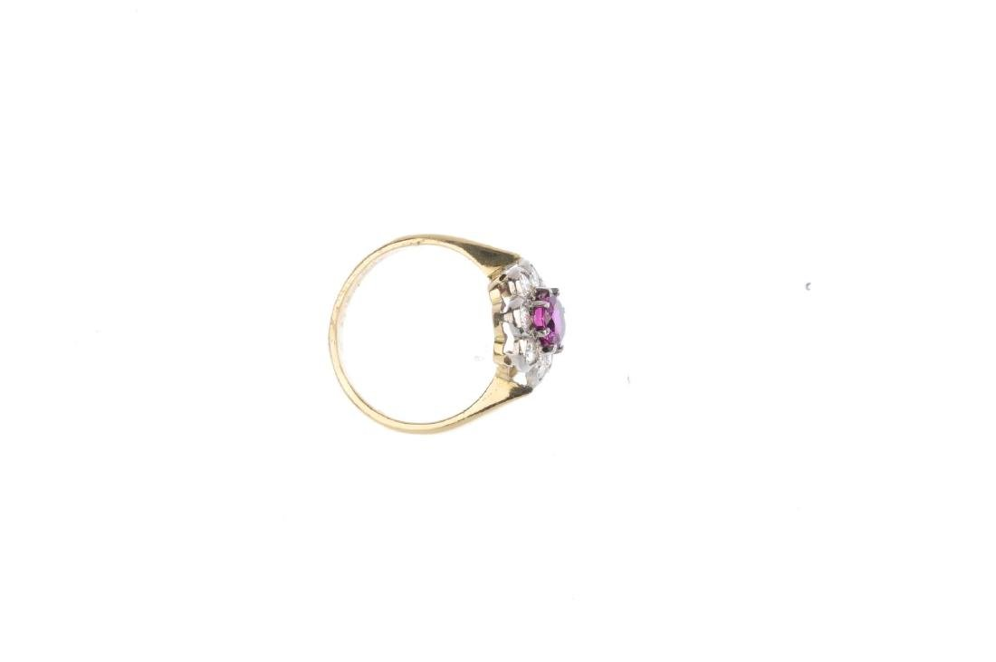 An 18ct gold Thai ruby and diamond cluster ring. The - 2