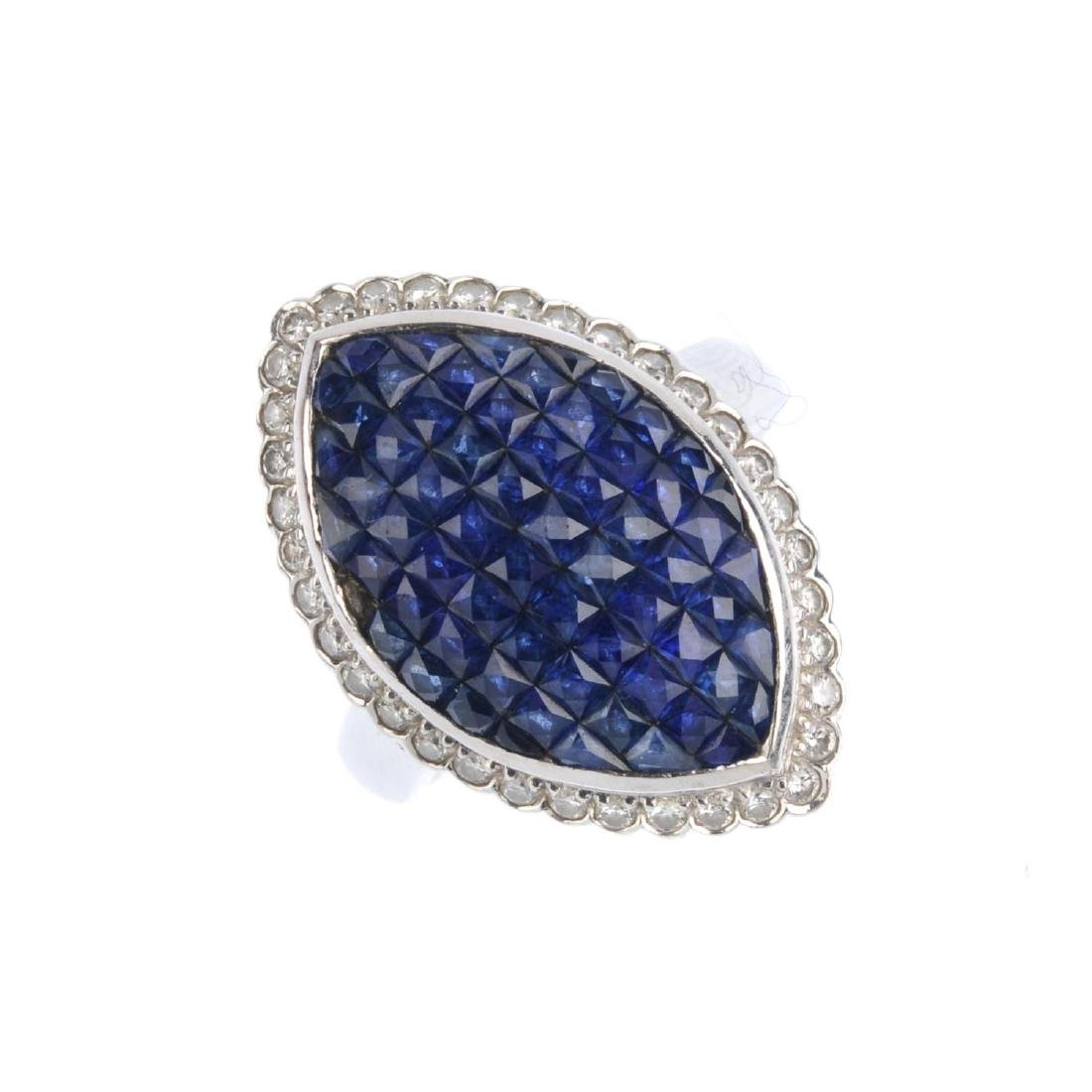 A sapphire and diamond dress ring. The calibre-cut