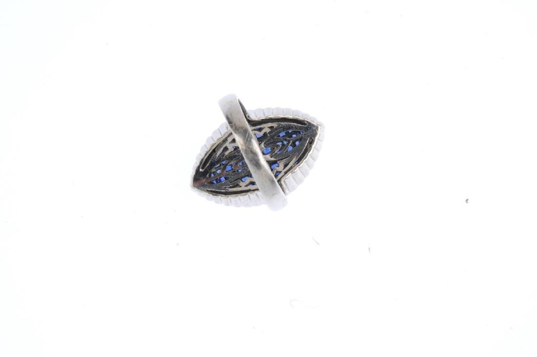 A sapphire and diamond dress ring. The calibre-cut - 3