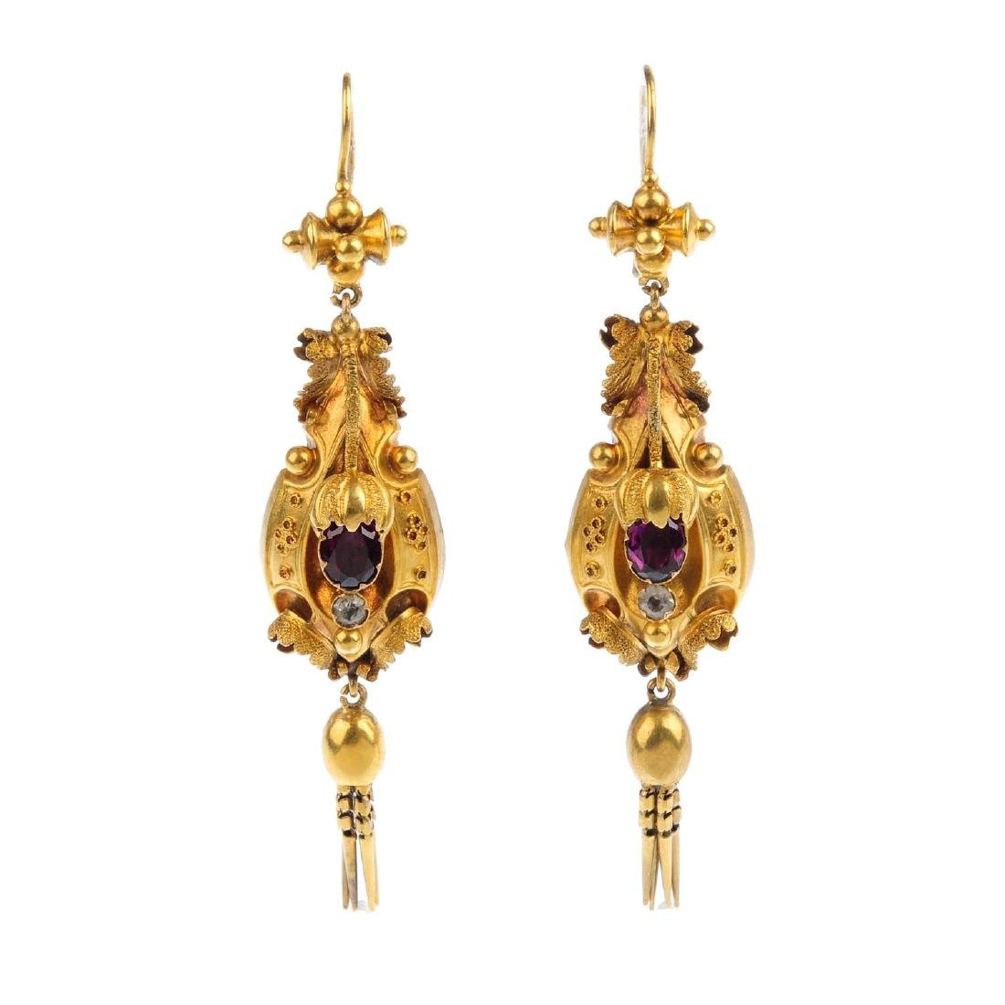 A pair of mid Victorian gold gem-set earrings. Each