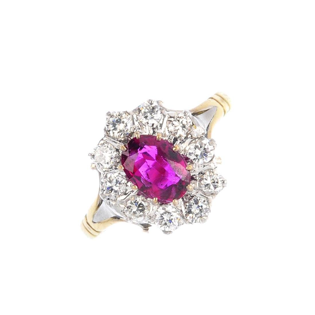 A Thai ruby and diamond cluster ring. The oval-shape