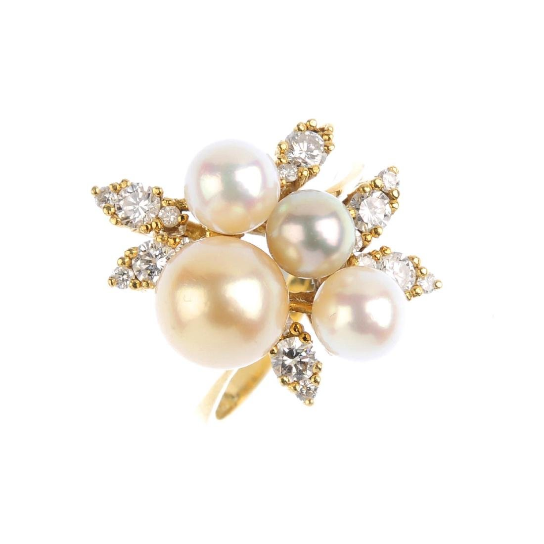 A cultured pearl and diamond dress ring. Designed as a
