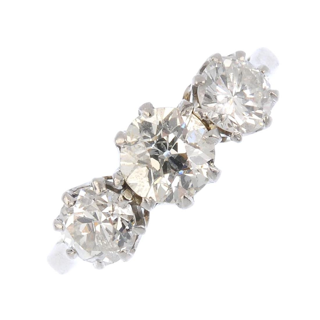 A diamond three-stone ring. Designed as a graduated