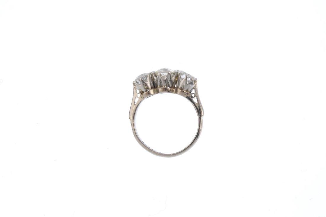 A diamond three-stone ring. Designed as a graduated - 2