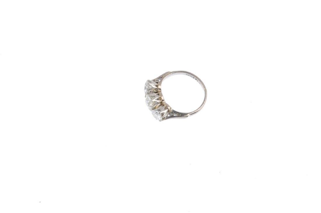 A diamond three-stone ring. Designed as a graduated - 3