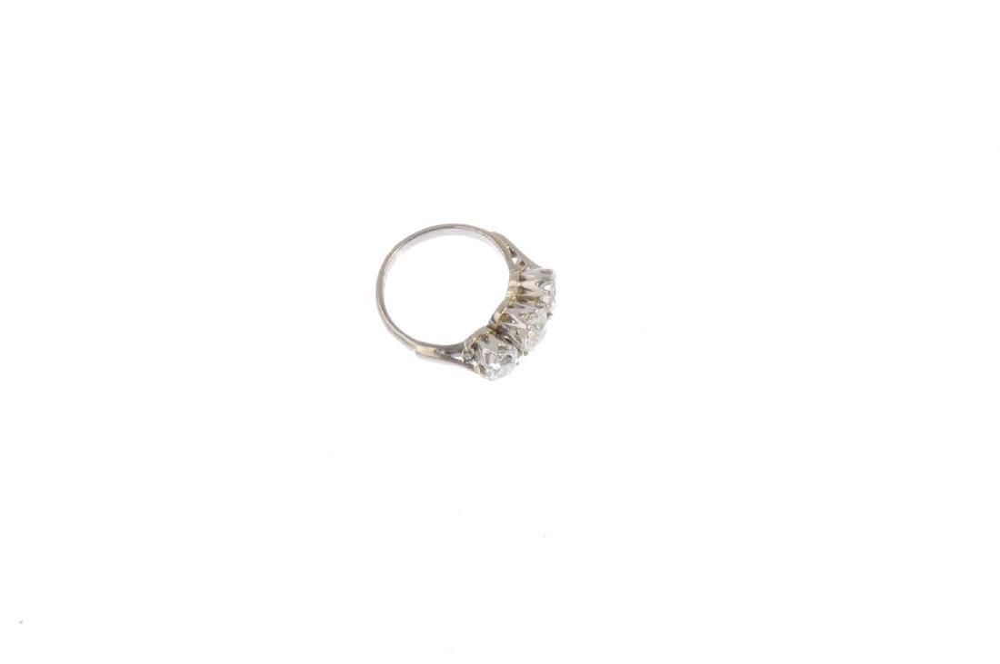 A diamond three-stone ring. Designed as a graduated - 4
