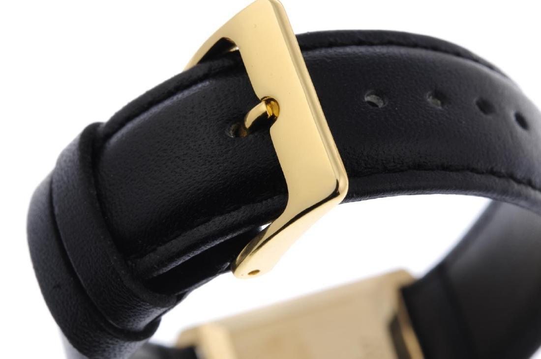 BAUME & MERCIER - a gentleman's wrist watch. Yellow - 2