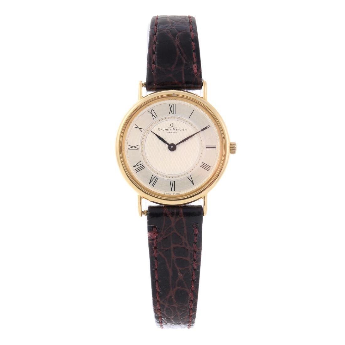 BAUME & MERCIER - a lady's wrist watch. 18ct yellow