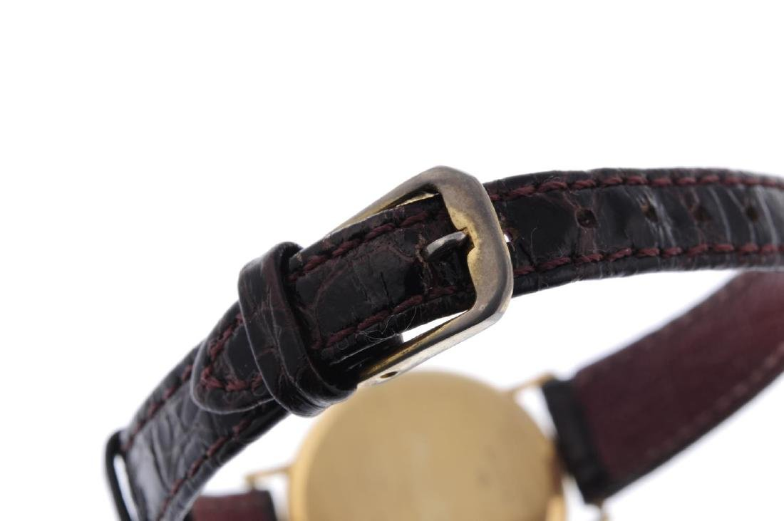 BAUME & MERCIER - a lady's wrist watch. 18ct yellow - 2