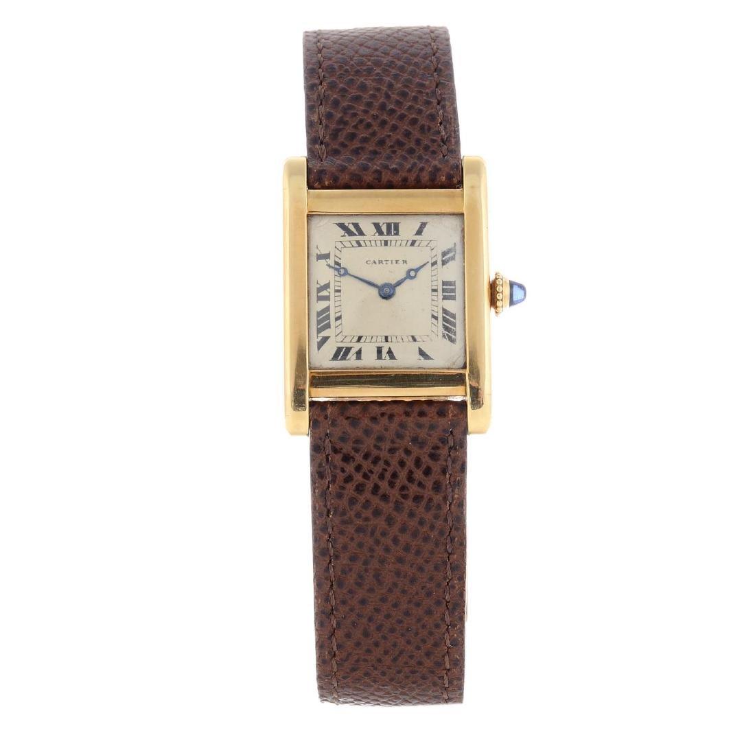 CARTIER - a Tank wrist watch. Yellow metal case stamped
