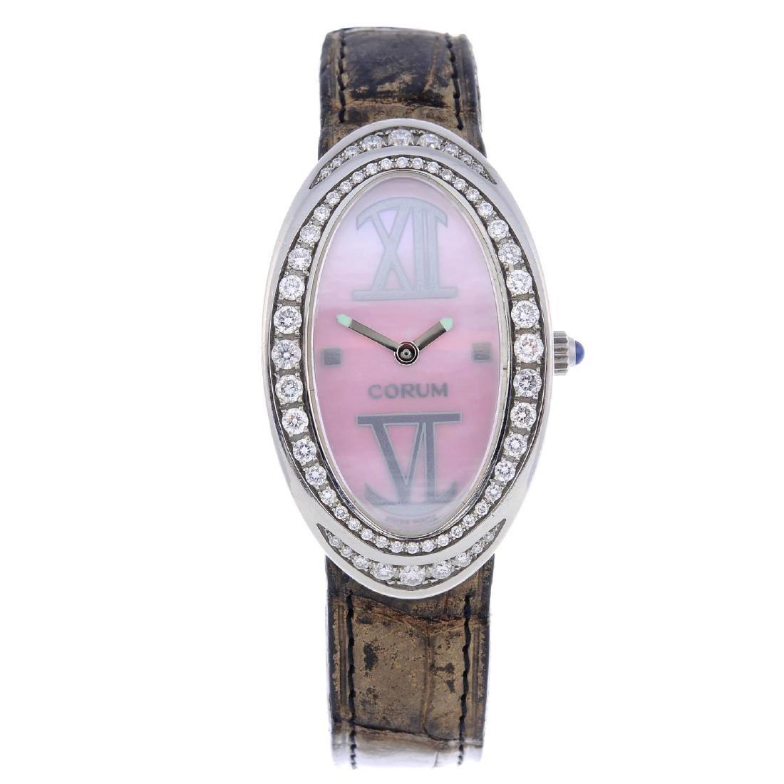 CORUM - a lady's Ovale wrist watch. Stainless steel