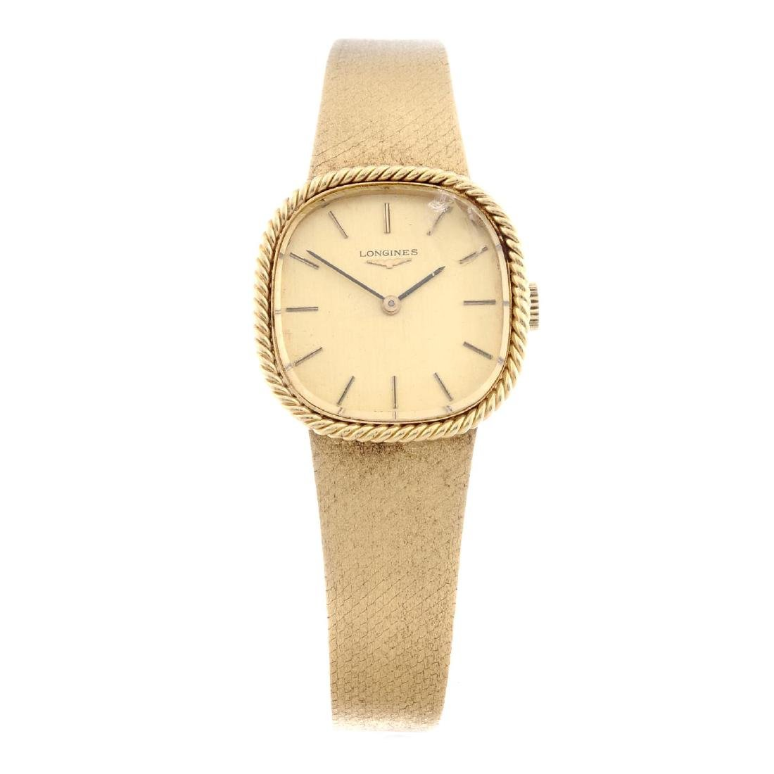 LONGINES - a lady's bracelet watch. Yellow metal case,